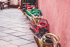 Colored watering can Royalty Free Stock Image