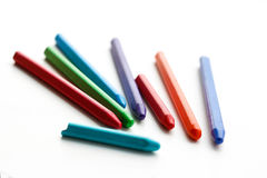 Colored wax crayons. Isolated on a white background. Closeup Stock Photo