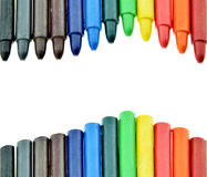Colored wax pencil or crayons on a white background. Royalty Free Stock Image