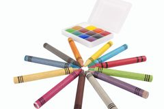 Colored wax pencils and a watercolor Royalty Free Stock Photo