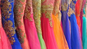Colored wedding dresses with gold embroidery. A big sale of colored and goldthread embroidered dresses in a silk shop in Mysore, India Stock Photo