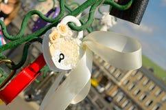 Colored wedding locks. Stock Images