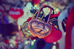 Colored wedding locks. Valentine's Day. Wedding's Day. Selective focus. Toned vintage photo. The inscription - Together forever stock photo