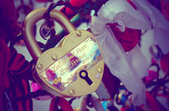 Colored wedding locks. Valentine's Day. Wedding's Day. Toned vintage photo stock photo