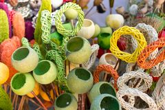 Colored wickerwork and poppy pods Stock Photo