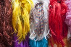 Colored wigs in the store. stock images