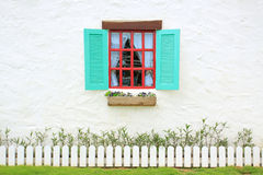 Colored windows on the wall background Stock Images