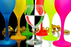 Colored wine glasses on a black and white backgrou Royalty Free Stock Photos