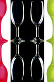 Colored wine glasses on black white background Royalty Free Stock Photos