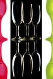 Colored wine glasses on black white background Royalty Free Stock Image