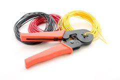 Colored wire and crimping tool. Details of colored strands of insulated electrical wire and a crimping tool Royalty Free Stock Images