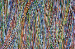 Colored wires in global telecommunications networks. As background Royalty Free Stock Photos