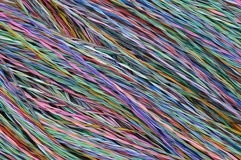 Colored wires in global telecommunications networks. As background Stock Images