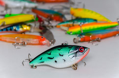 Colored wobblers for fishing. On a light background stock photo