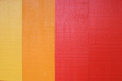 Colored Wood. Painted wood background in red, yellow and orange stock photo
