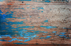 Colored wood background with peeling old paint Royalty Free Stock Photos