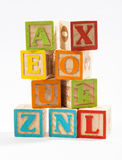 Colored Wooden Alphabet Blocks on White Background Stock Photo