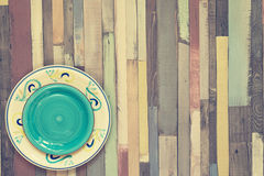 Colored wooden background two plates Royalty Free Stock Photos