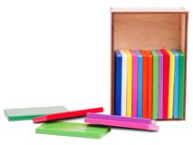Colored wooden bars for children, in a box, isolated on a white background Stock Image