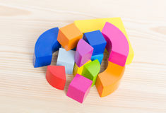 Colored wooden blocks, cubes, build on a light wooden background. Art; blocks; math; childhood; classroom; color; education; fun; game; kids; kindergarten Royalty Free Stock Images