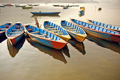 Colored wooden boat Stock Photos