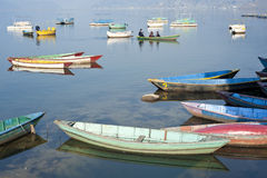 Colored wooden boat. Bright colored wooden boats in Pokhara Royalty Free Stock Image