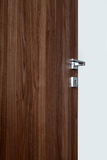 Colored wooden door open d. Colored wooden door open, with the handle, on white background royalty free stock image