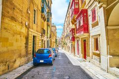 Decorative elements of Maltese architecture, Valletta. The colored wooden doors, window frames and balconies are traditional decorative elements of Maltese Royalty Free Stock Photo