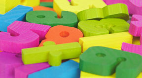 Colored wooden letters and numbers. Bunch of colored wooden toy letters and numbers stock image