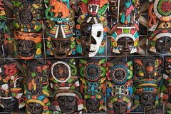 Colored wooden masks at a souvenir stand in Chichen Itza, Yucatan, Mexico.  stock image