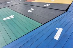 Colored wooden panels with large white numbers. Painted wooden panels in blue, green, yellow, red and black with large white numbers Stock Photo