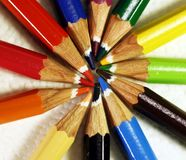Colored wooden pencils arranged in the shape of rays stock images