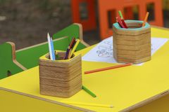 Colored wooden pencils on the table Stock Images