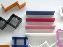 Colored wooden shelves on the wall. Colored wooden shelves attached to the wall Stock Photos