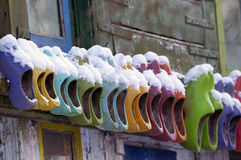 Colored wooden shoes on wall Stock Photos