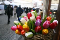 Colored wooden tulips. In Vilnius old town, Lithuania Royalty Free Stock Photos