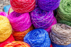 Colored wool. Colored balls of wool as seen on a market in Peru Stock Photos