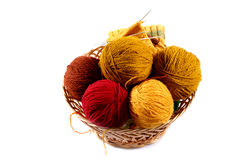 Colored wool balls in wicker basket Stock Photography