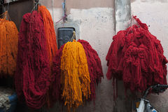 Colored wool - coloured wool. Fresh colored sheeps wool hanging out for drying in the small streets of the medina of Marrakesh, Morocco royalty free stock photography