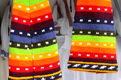 Colored wool hats. Details of colored wool hats suspended Stock Photography