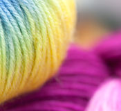 Colored wool knitting yarns Stock Images