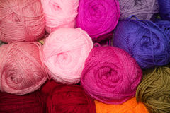 Colored wool. Many woolen yarn pink color, variegated texture royalty free stock images