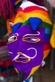 Colored woolen mask for sale at the market in Cusco, Peru. Peruvian colored woolen mask for sale at the tourist craft market in Cusco. Peru Stock Photos