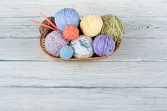 Colored yarn on a white background. Skeins of wool yarn for knitting. Balls of wool with spokes of different colours for. Colored yarn on a white background stock image