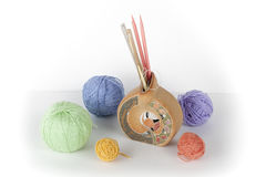Colored yarn on a white background. Skeins of wool yarn for knitting. Balls of wool with spokes of different colours for. Colored yarn on a white background Royalty Free Stock Photos