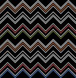 Colored zig-zag pattern on black. Seamless chevron texture Stock Image
