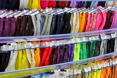 Colored zippers are arranged in beautiful rows, colorful, zipper for sewing. needlework royalty free stock image