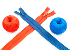 Colored zippers and tread Royalty Free Stock Image