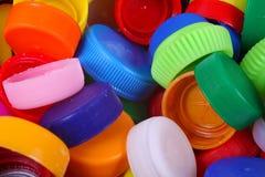 Coloree el fondo de los casquillos del plástico Imagen de archivo libre de regalías