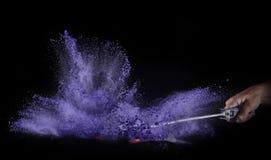 Coloree el polvo estallado, aislado en el ambiente del control Imagenes de archivo